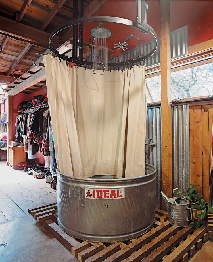 The showers are made from stock-watering tanks from the Ideal Stock Tank Co. and have waterproof canvas curtains. Less expensive than prefab shower-tub units, stock tanks are built of weatherproof galvanized steel and are sturdy enough for cows to drink f