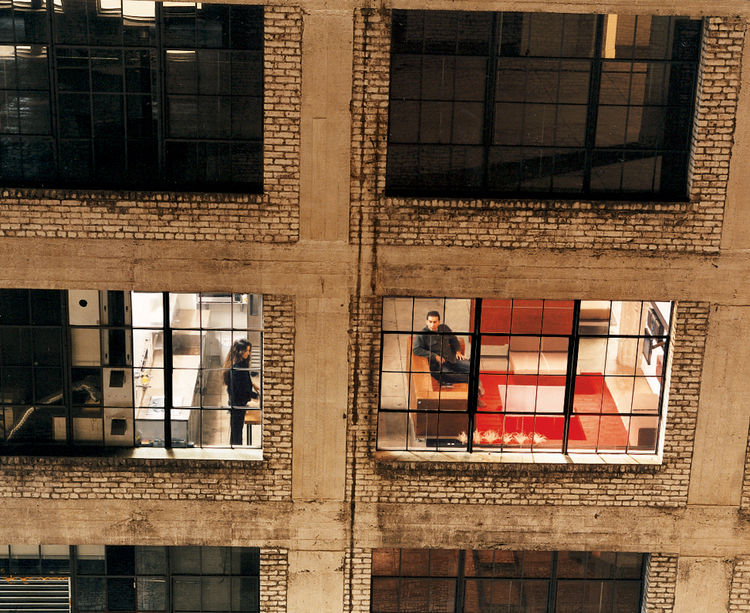 The mini-loft concept was simple enough: The space had to function as a traditional loft—high ceilings, open floor plan, large windows, and the sense of expansiveness offered by much larger lofts. Seems reasonable until you remember they had to squeeze a