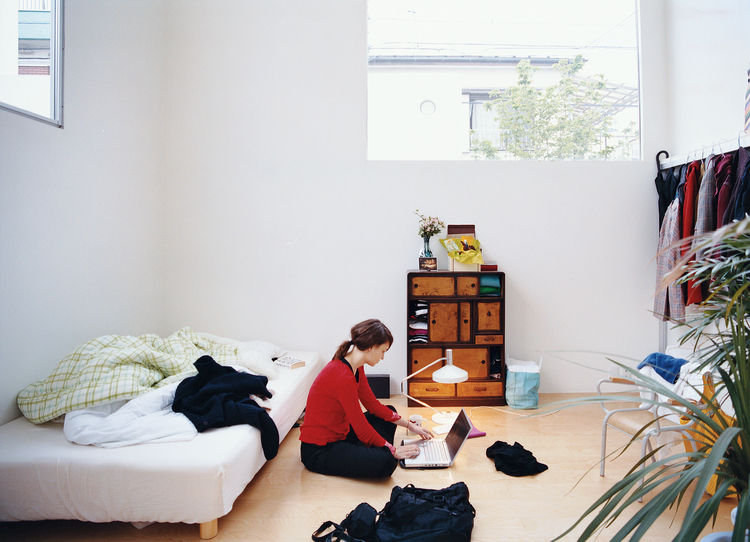 Johanna Meyer-Grohbruegge, the newest resident and one of the rotating international architects in Ryue Nishizawa's office, works in the sanctuary of her room (Unit I).