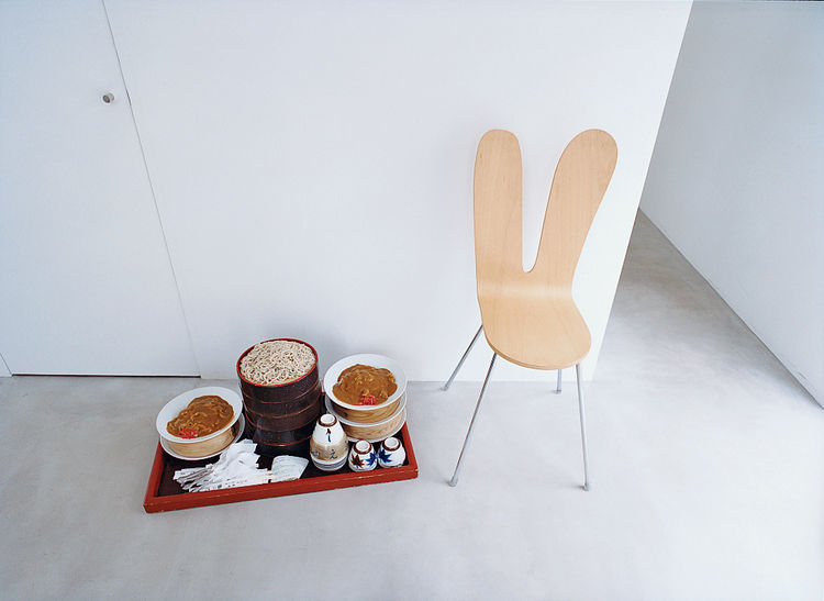 A stream of curious visitors necessitates plenty of takeout. The 2946-23 chair by Kazuyo Sejima and Ryue Nishizawa for NextMaruni (waits patiently near a fresh delivery of soba noodles and curry.