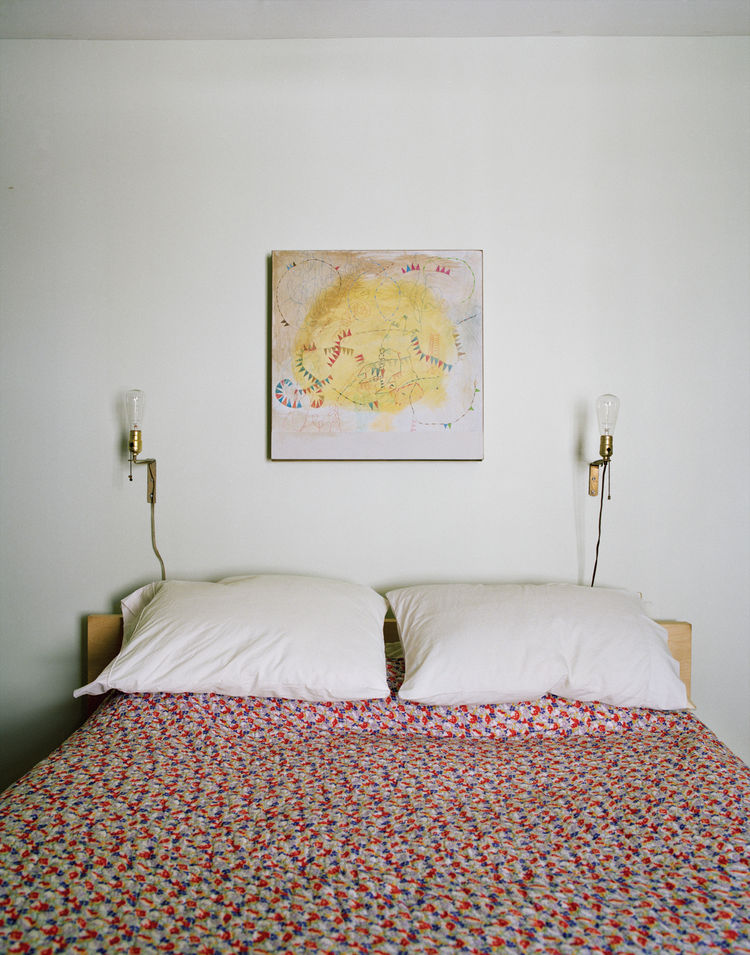 The master bedroom of the Rice and Nissenboim residence featuring an original painting by Rice.