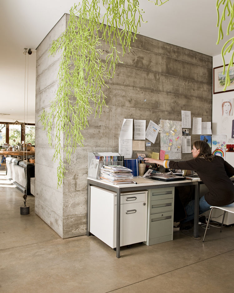 The open office space is partially secluded thanks to the hanging Algues by Ronan & Erwan Bouroullec for Vitra.