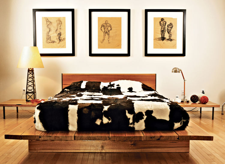 Graphic cowhides on the guest bed, the dining chairs, and the living room floor unite the varying levels of the house. That design element—and the cute oil derrick lamp in the guest bedroom—remind you that, yes, you are in Texas. The drawings are by Erik'