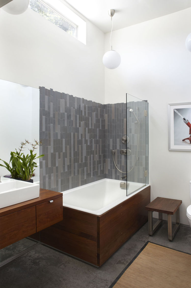 "Shoup accentuated the feeling of space in the master bath by opening it up to the full ceiling height. Ipe wood sheathes the sink and tub. ""The tile has the appearance of stranding to play off the bamboo in the bedroom,"" notes Shoup, who sourced the tile"