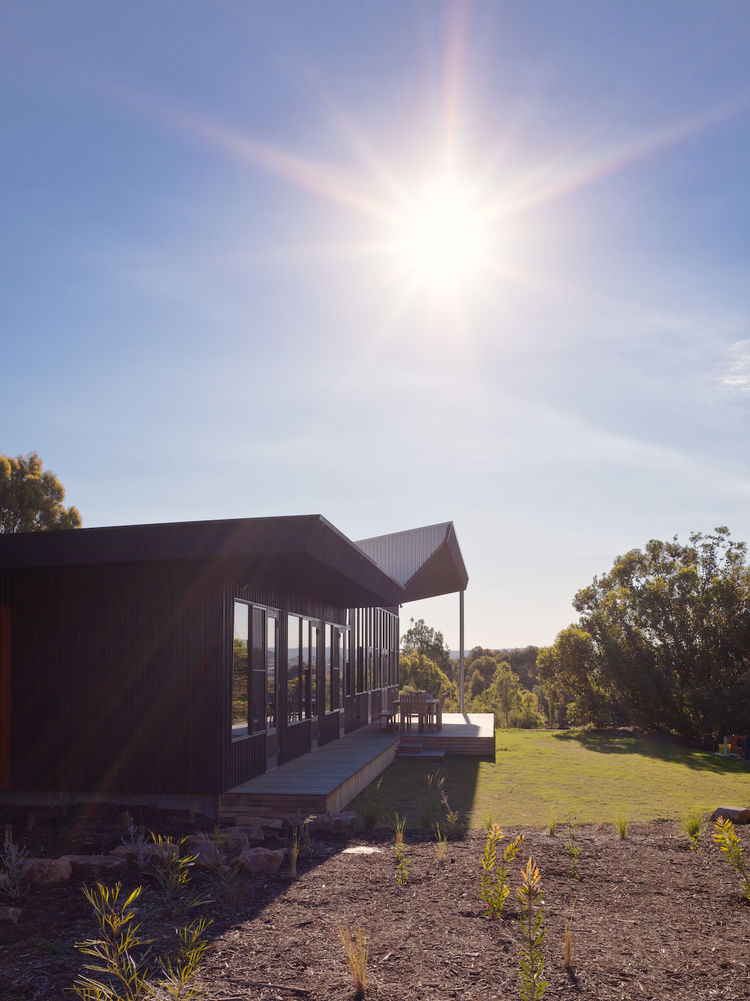 With a hardworking solar array, the Courtyard House pumps energy back into the electric grid. The site also has an elaborate water filtration system which collects more than it uses, and that includes watering a massive garden.