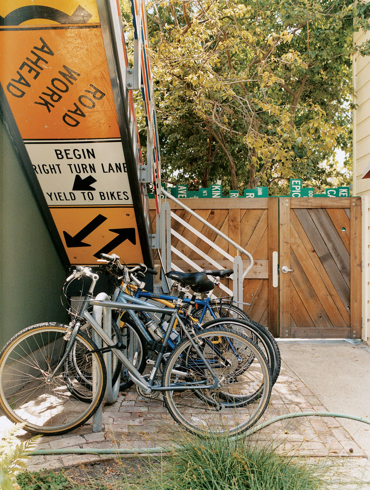 Residents park their bikes under the stairs, which lead to the second-floor units.