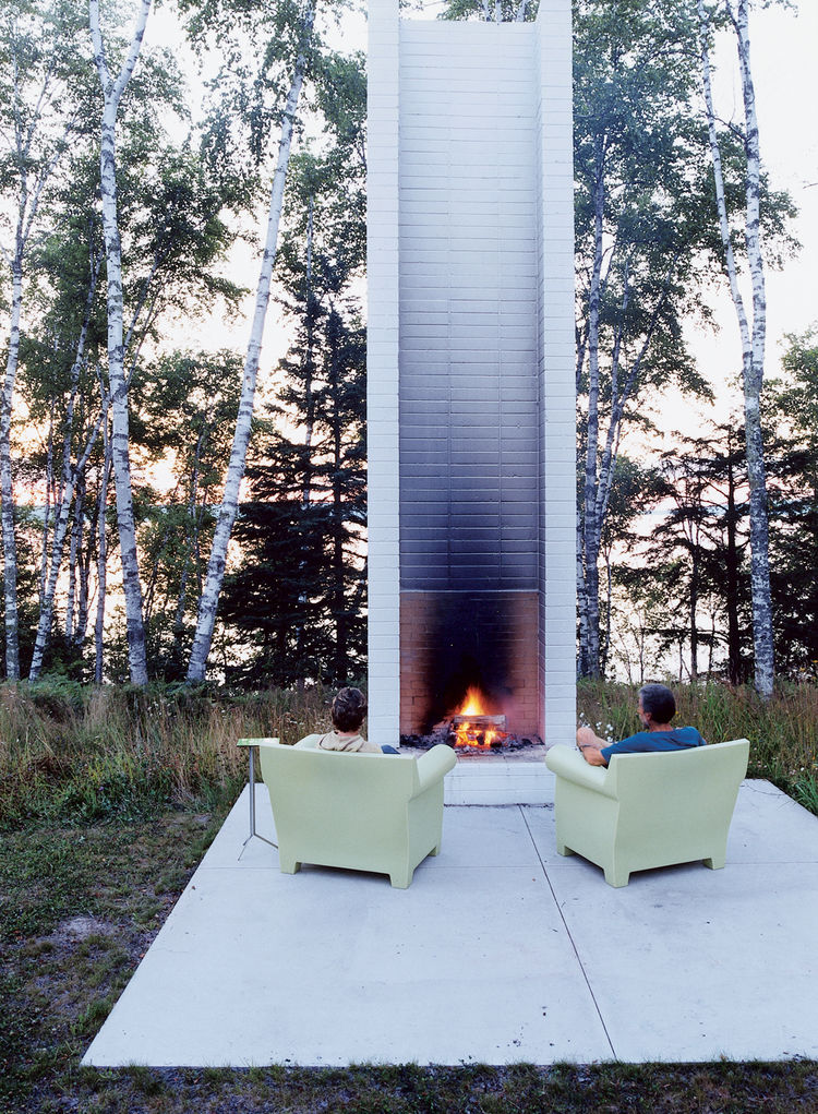 "Philippe Starck's outdoor chairs for Kartell provide cozy fireside seating. These and the sofa version were selected by Salmela. ""They're very much an art form,"" he says."