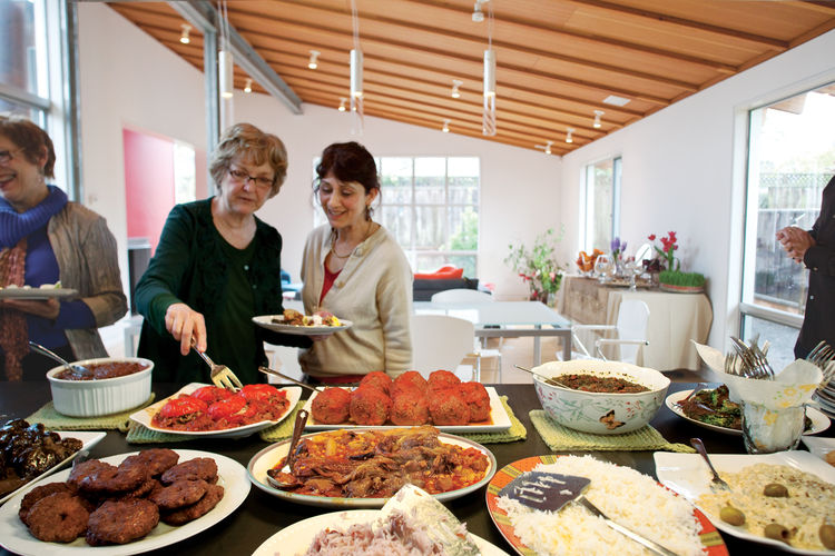 """A feast that includes stuffed tomatoes and giant meatballs called """"koofteh."""""""