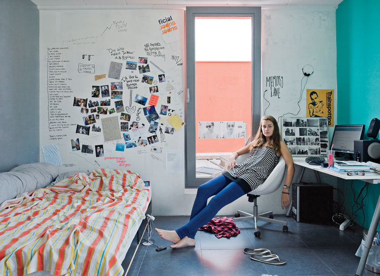 Thijske Noordhoek relaxes in her study-cum-bedroom.