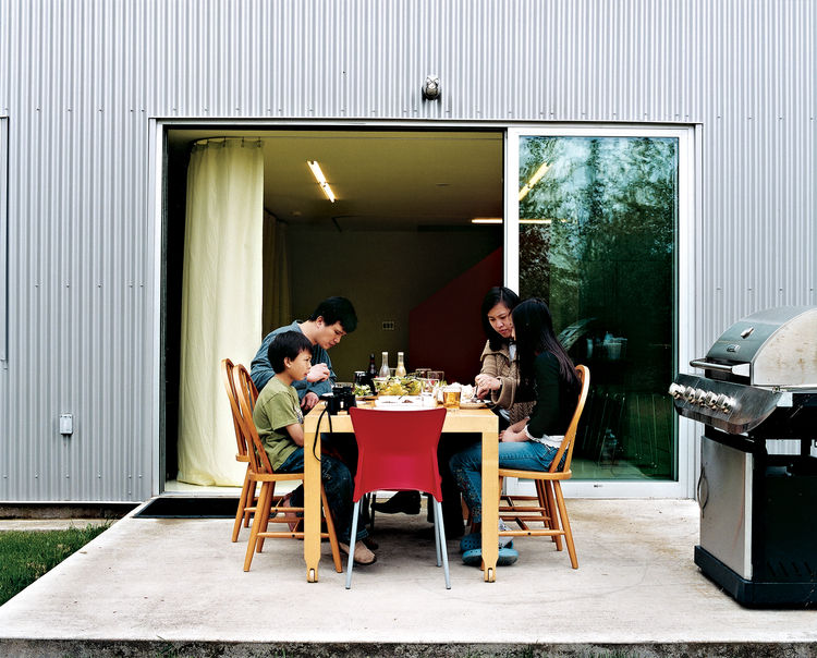"The Wibowo family spends most of their time together on the first floor. ""We're always here, cooking or with the kids,"" Wibowo explains. ""On a nice day, we open up the doors and eat outside."""