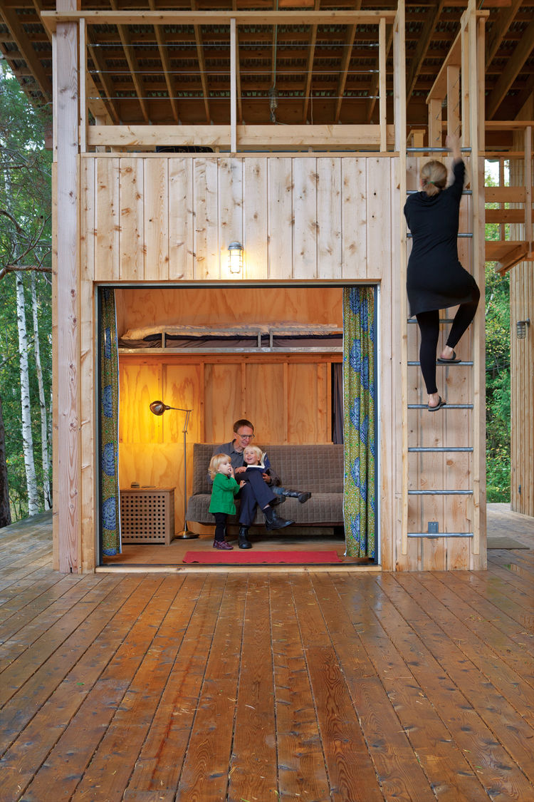 Wooden guest cabin rooms with ladder