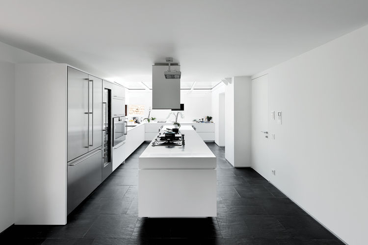 Minimalist clean white silver kitchen