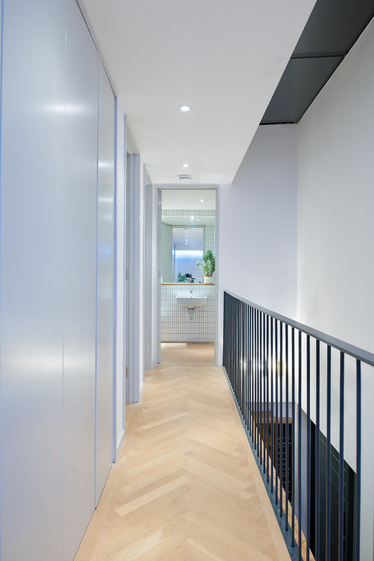 Sleek monochrome upstairs hallway