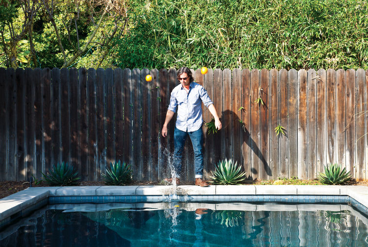 Modern outdoor pool with wooden fence