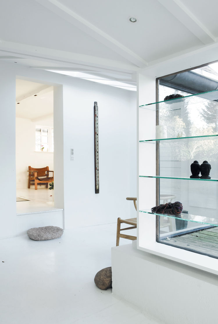 Skylight in entrance minimalist glass shelves