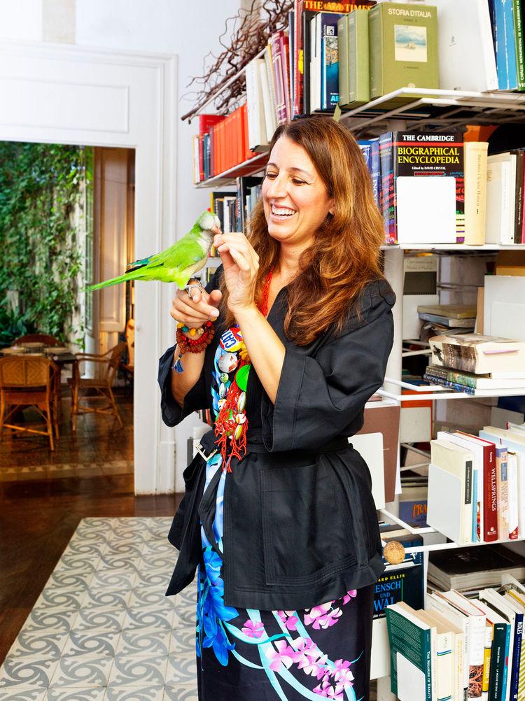 Italian architect Benedetta Tagliabue feeding her pet bird