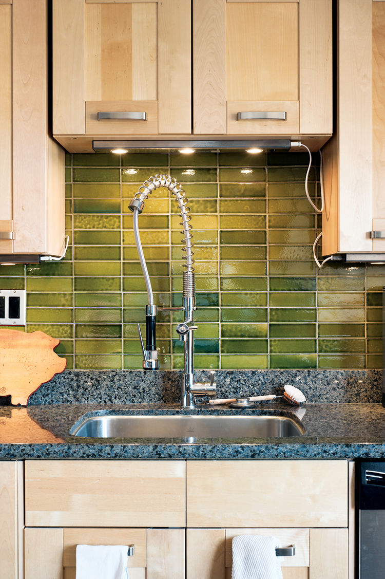 Textured tiled wall with fixtures in kitchen