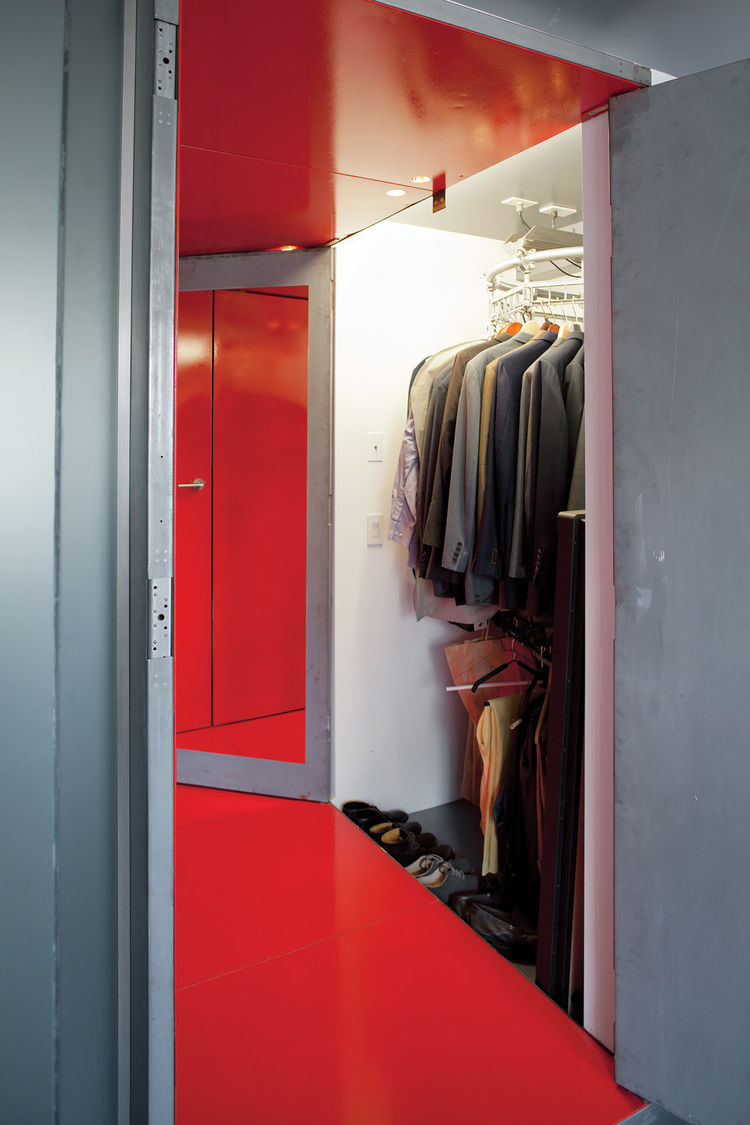 Narrow hallway hidden closet with metal walls