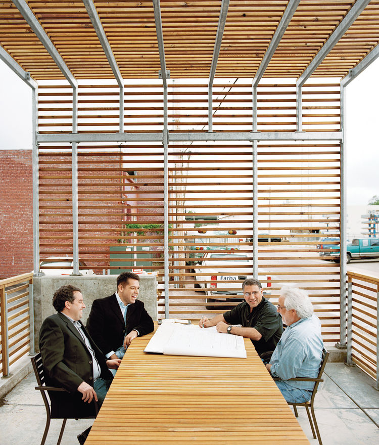 Interior view of the steel-and-cedar slat patio on the Finn Lofts