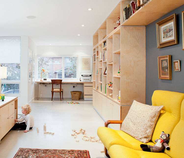 Moden office with yellow sofa and custom millwork