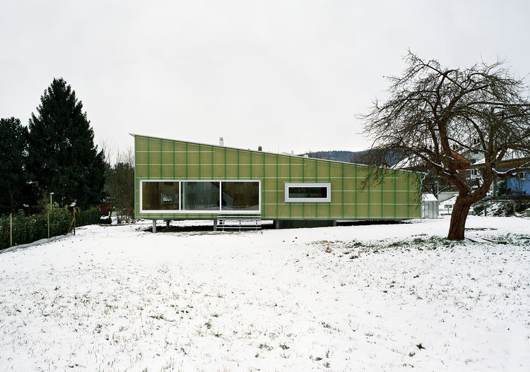 green straw and concrete eco-home in Switzerland