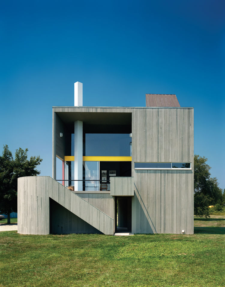 Modern wood-frame home clad in vertical cedar siding