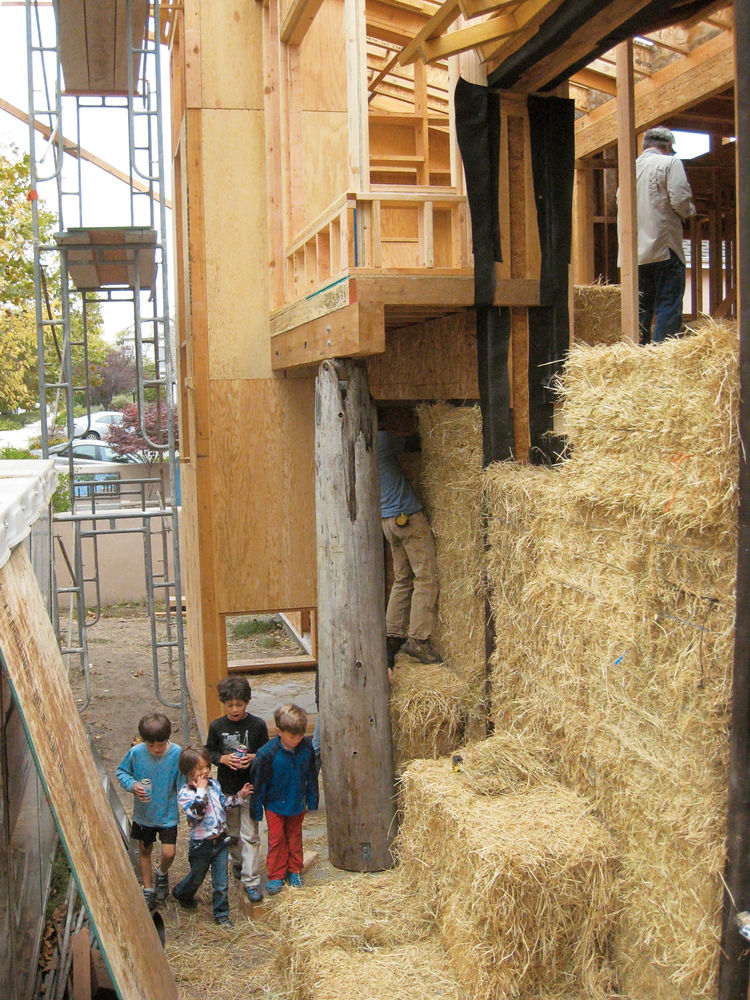 Modern outdoor bale raising with wood l-joists