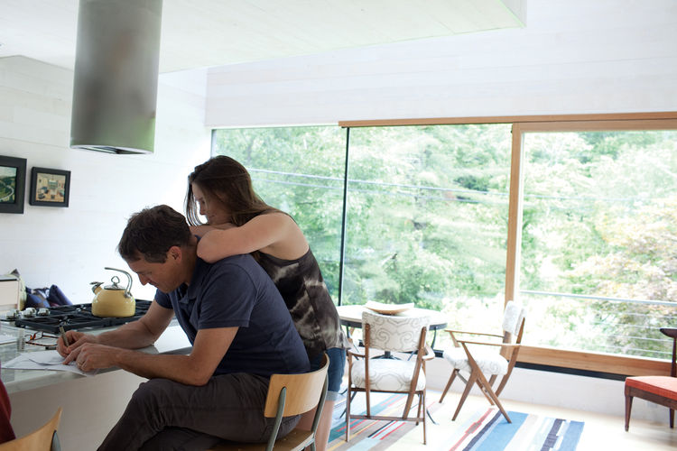 Father and daughter in their modern kitchen