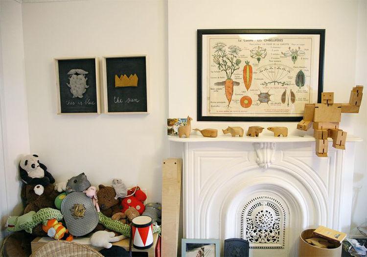 Marius's toys around the fireplace.