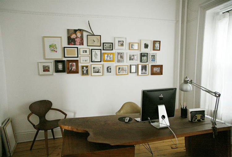 Photo wall over desk.