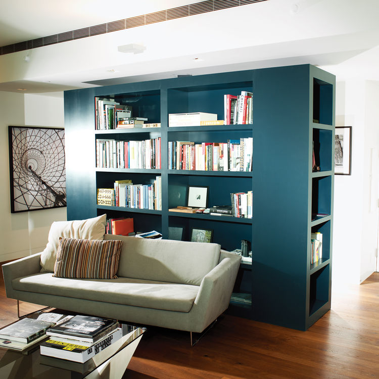 Modern library with green custom wraparound bookcase