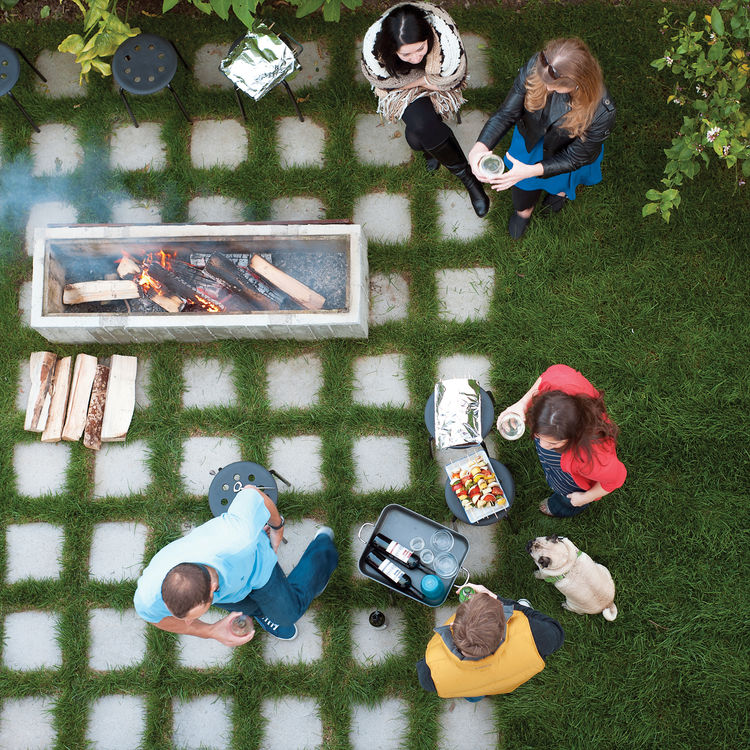 Outdoor fire with tiled stone flooring