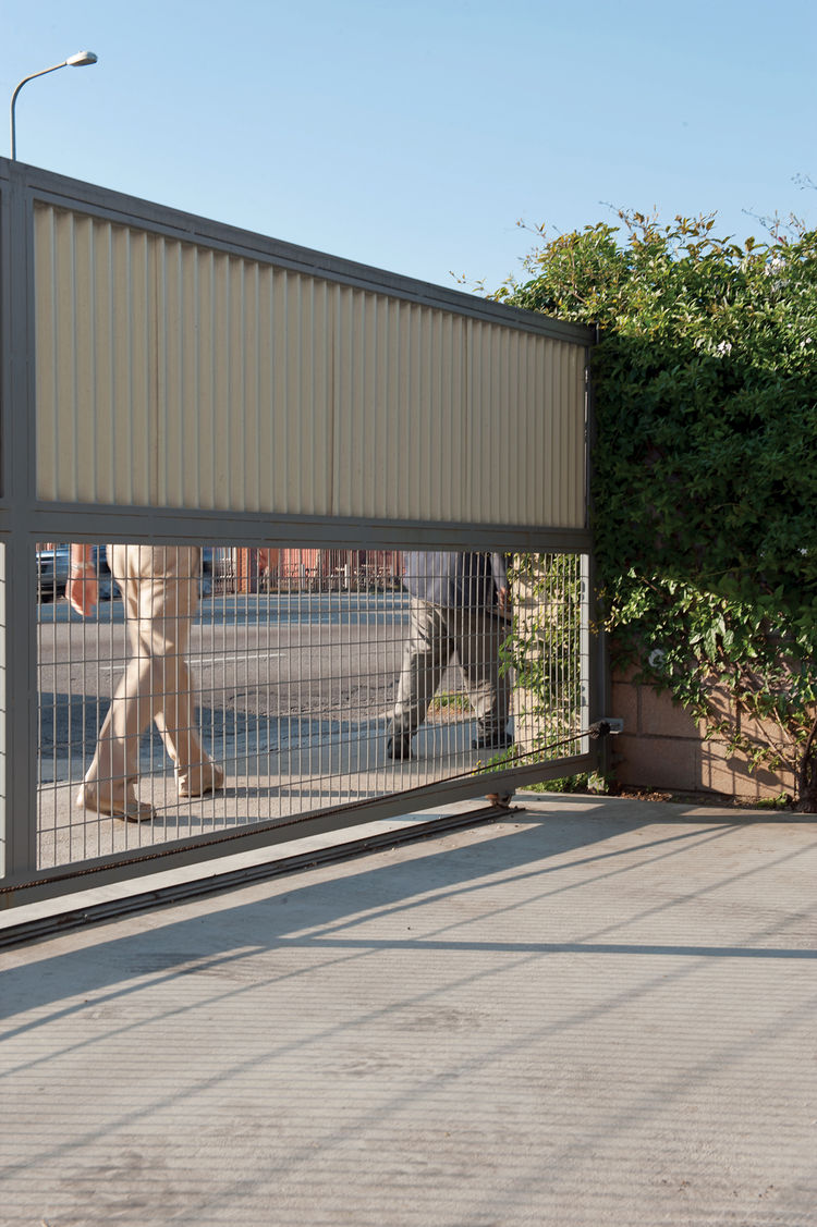 Modern outdoor sheet metal property gate