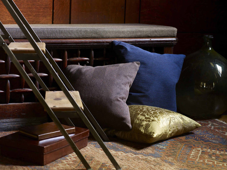 modern grey, blue, and gold pillows by Knoll