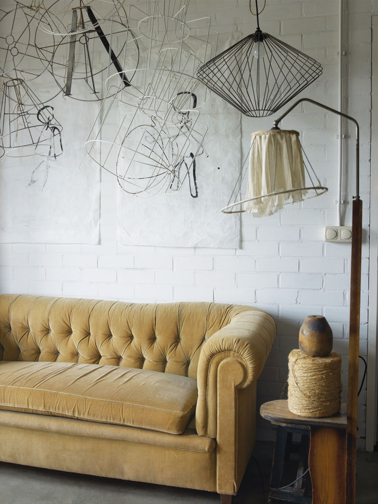 Felt studio space with antique yellow sofa