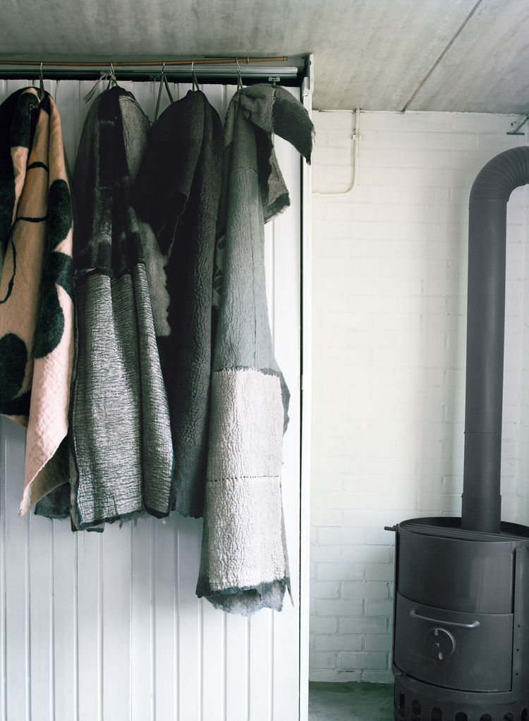 Handmade felt textiles on rack
