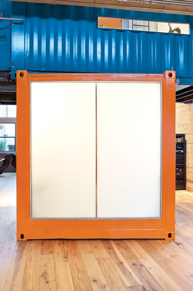 Shipping container room with Polytronix glass wall