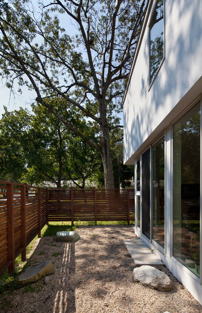 Outdoor backyard area with see-through wooden fence