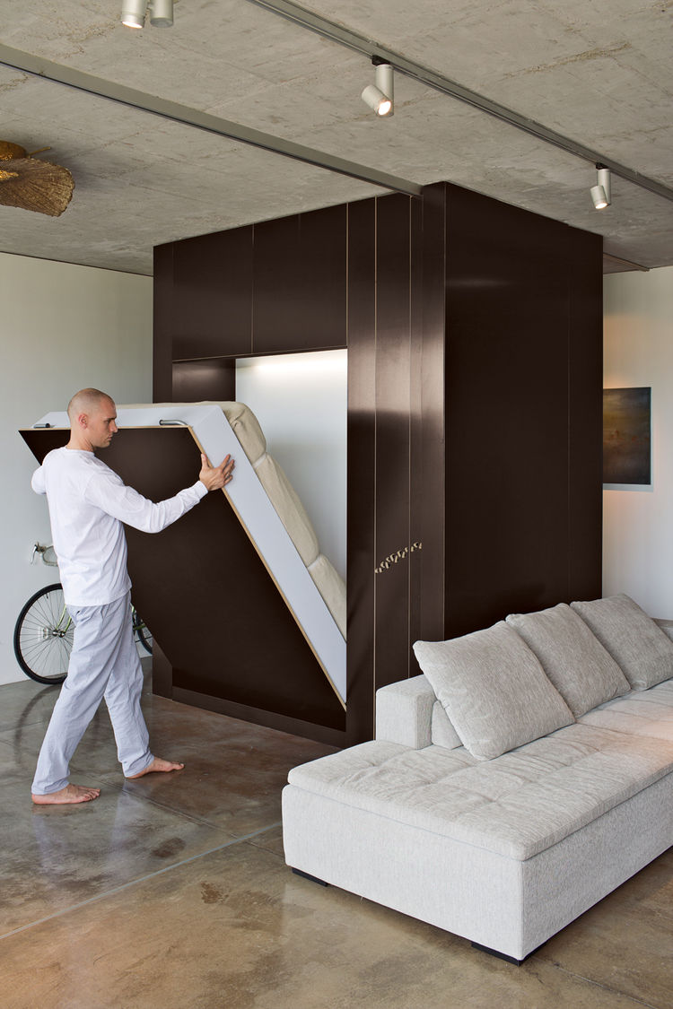 Lowering the custom encased Murphy bed