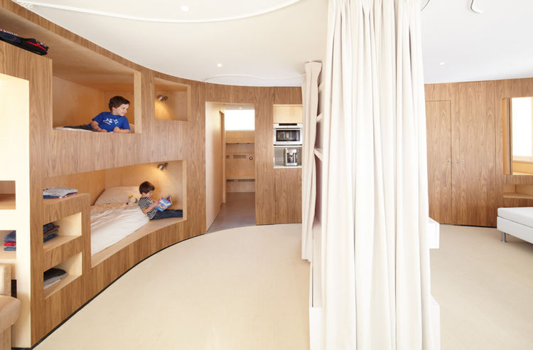 Wraparound wooden bedroom with bunk bed nooks