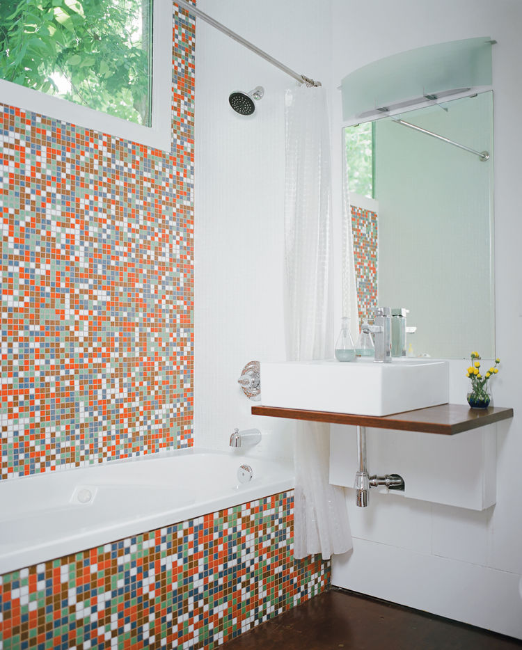 "Robertson--with the help of <a href=""http://numendevelopment.com"">developers Katie Nichols and John Walker</a>, who were heavily involved in the design process--finished the guest bathroom with <a href=""www.modwalls.com"">Modwalls</a> tiles and a sink they"