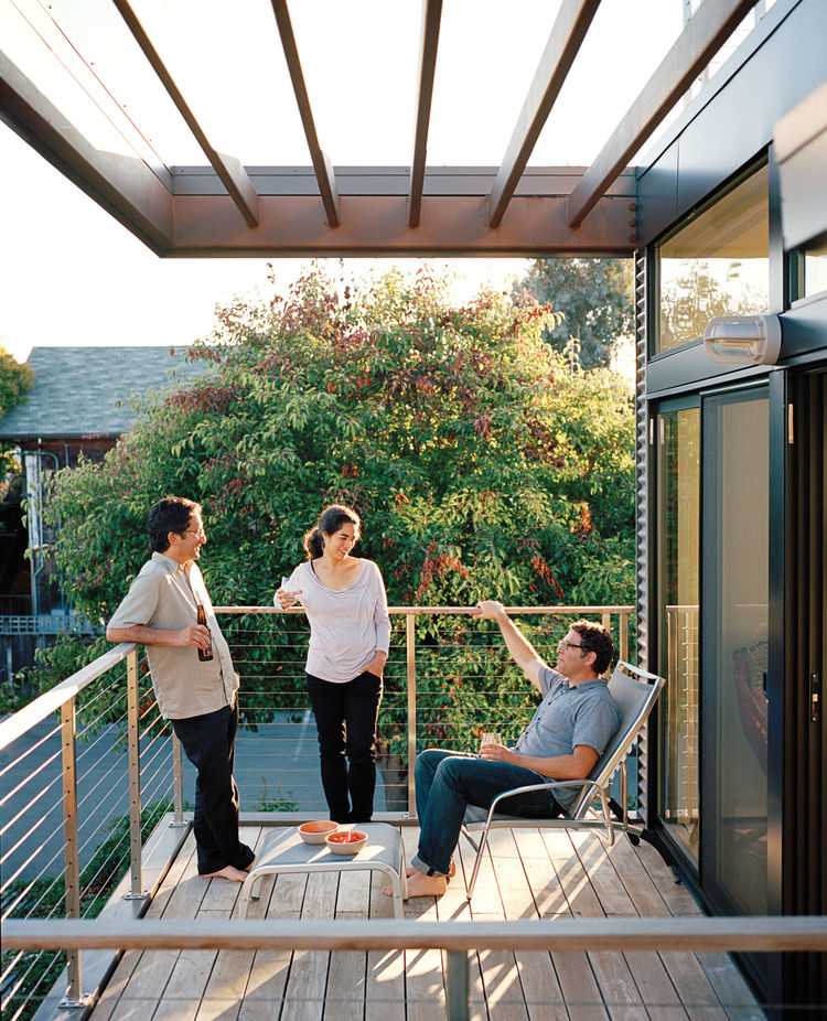 Balcony clad in concrete block, corrugated metal, and Parklex