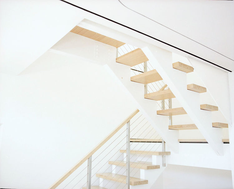Indoor staircase with bamboo treads and handrail