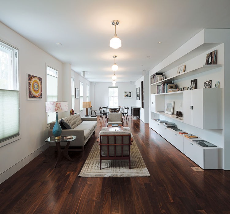 Living dining room with wooden flooring and Wells sofa