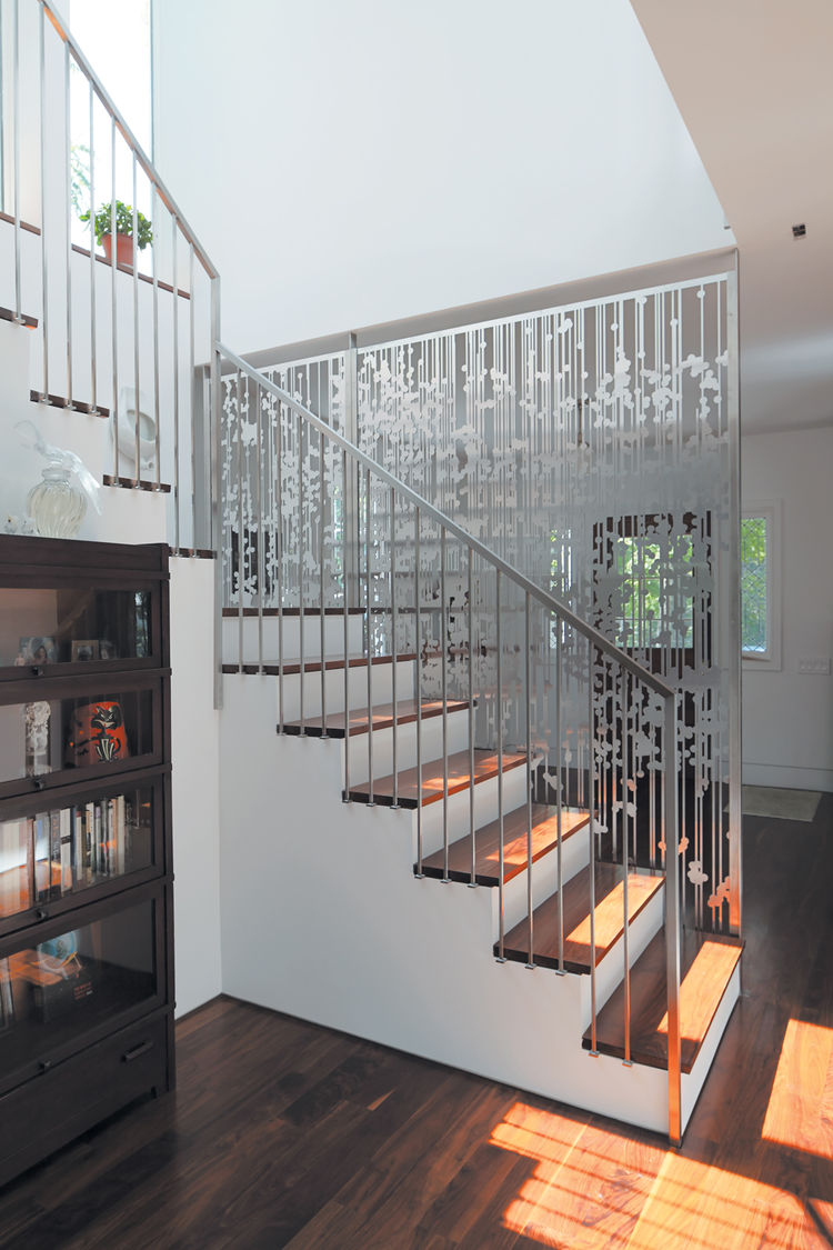 Staircase area with aluminum hanging screen