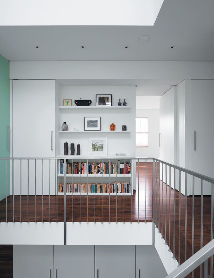 Wooden hallway with skylight and bookshelves