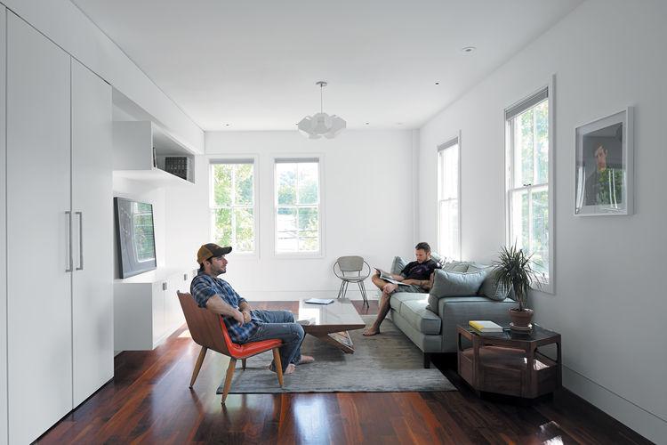 WIndow-lit living room with wooden flooring