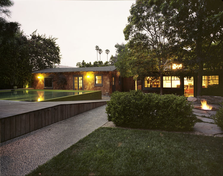 Backyard view of modern pool house