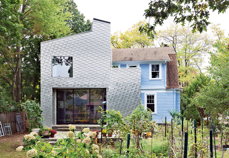 Modern facade clad in recycled aluminum shingles