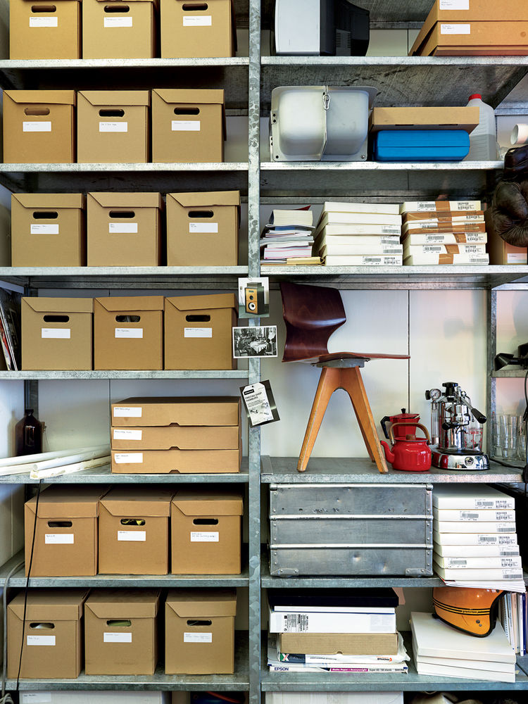 Metal shelving system with wooden storage boxes